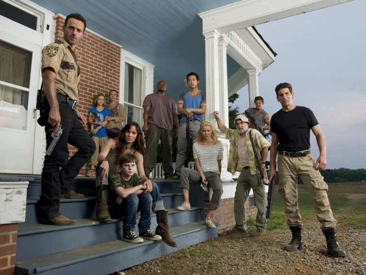 (L-R) Rick Grimes (Andrew Lincoln), Sophia (Madison Lintz), Carol (Melissa Suzanne McBride), Lori Grimes (Sarah Wayne Callies), Carl Grimes (Chandler Riggs), T-Dog (Robert 'IronE' Singleton), Glenn (Steven Yeun), Andrea (Laurie Holden), Dale (Jeffrey DeMunn), Daryl Dixon (Norman Reedus) and Shane Walsh (Jon Bernthal) - The Walking Dead - Photo Credit: Matthew Welch/AMC - TWD2_GAL_Porch_Group_0141